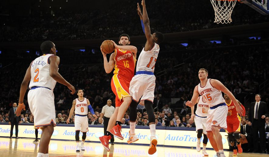 Houston Rockets forward Kostas Papanikolaou (16) passes the ball around New York Knicks forward Cleanthony Early (17) as guard Langston Galloway (2) and guard Tim Hardaway Jr. (5) defend in the first half of an NBA basketball game on Thursday, Jan. 8, 2015, in New York. (AP Photo/Kathy Kmonicek)