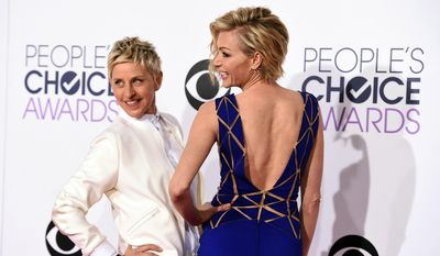 Ellen DeGeneres, left, and Portia de Rossi arrive at the People's Choice Awards at the Nokia Theatre on Wednesday, Jan. 7, 2015, in Los Angeles. (Photo by Jordan Strauss/Invision/AP)