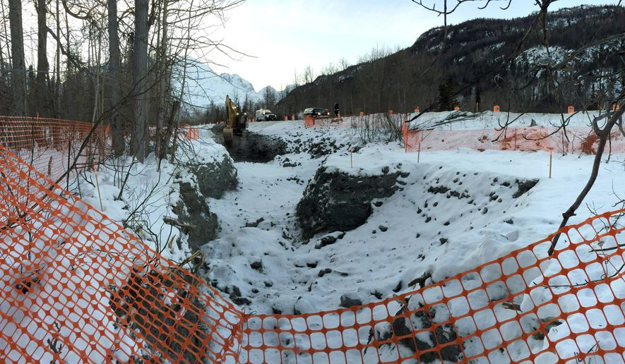 In this photo provided by the Alaska Department of Environmental Conservation, the evacuated area where diesel gasoline from a ruptured oil tanker is seen on Jan. 6, 2015, near Valdez, Alaska. The government has stepped in to continue cleaning up more than 4,000 gallons of diesel that spilled into a creek after a tanker slid off the Richardson Highway near Valdez. Much of the fuel in the Dec. 9 spill remains frozen in the roadside creek bed. The North Pole distribution company that operated the tanker doesn't have enough insurance to finish the clean-up, prompting the federal Environmental Protection Agency to assume overall command of the effort. (AP Photo/Alaska Department of Environmental Conservation, John Engles)
