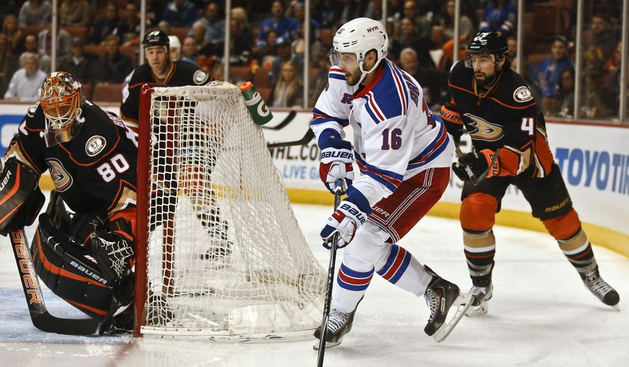 New York Rangers center Derick Brassard moves to center the puck behind the Anaheim Ducks net as Ducks defenseman Cam Fowler pursues during the first period of an NHL hockey game Wednesday, Jan. 7, 2015, in Anaheim, Calif. (AP Photo/Lenny Ignelzi)