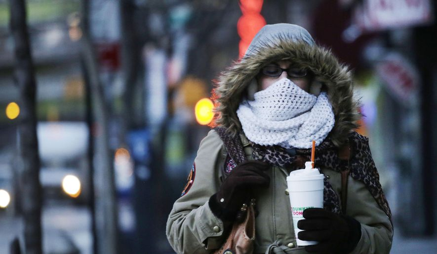 A woman carries a beverage in a plastic foam cup, Thursday, Jan. 8, 2015 in New York. Nearly two years after former Mayor Michael Bloomberg suggested banning foam food containers, Mayor Bill de Blasio is expected to announce the ban is a reality. (AP Photo/Mark Lennihan)