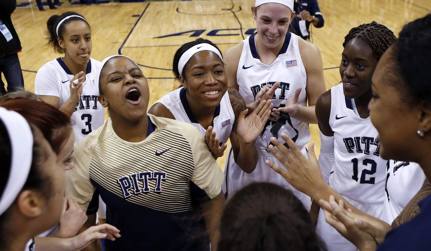 Pittsburgh's Brianna Kiesel (3) and Monica Wignot, upper right, celebrate after upsetting North Carolina in an NCAA college basketball game on Thursday, Jan. 8, 2015, in Pittsburgh. (AP Photo/Keith Srakocic)