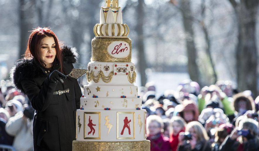 Priscilla Presley cuts the eight-tiered birthday cake during the 80th birthday celebration for her late ex-husband Elvis Presley at Graceland, Thursday, Jan. 8, 2015, in Memphis, Tenn. A large crowd gathered for the celebration even though the temperature was below 20 degrees. (AP Photo/The Commercial Appeal, Brad Vest)