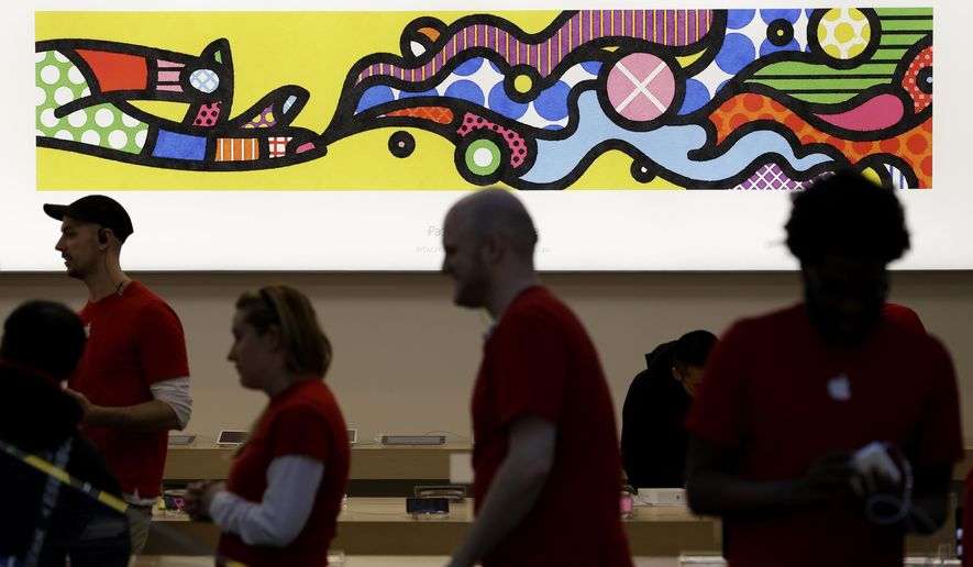 Artwork from artists Craig Redman and Karl Maier is on display on the wall of an Apple Store in New York, Thursday, Jan. 8, 2015. Apple is turning its retail stores into art galleries featuring the work of professional photographers and other artists who use iPads, iPhones and Mac computers to create. (AP Photo/Seth Wenig)