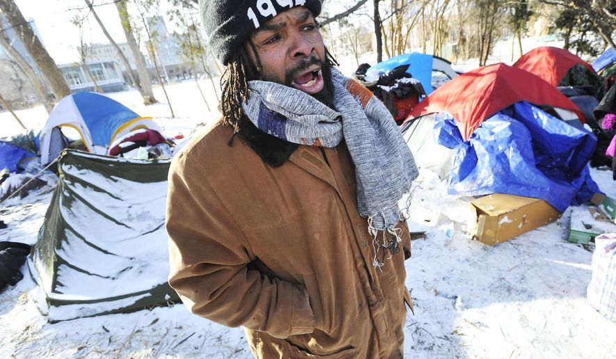 Stephon Jones, 50, a resident of the tent city is photographed on Wednesday, Jan. 7, 2015 In Detroit.  Mayor Mike Duggan says the city will move people to shelters from a tent city that sprouted in a small park.  The number of tents has grown slowly since the camp first appeared several months ago. Some residents say they prefer living outdoors to shelters. But it appeared deserted Thursday as wind chill temperatures were minus-15 degrees. (AP Photo/Detroit News, Daniel Mears)  DETROIT FREE PRESS OUT; HUFFINGTON POST OUT