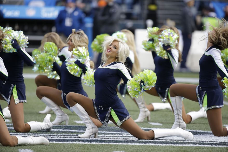 Seattle Seahawks Sea Gals cheerleaders perform during an NFL football game between the Seattle Seahawks and the St. Louis Rams, Sunday, Dec. 28, 2014, in Seattle. (AP Photo/Elaine Thompson)