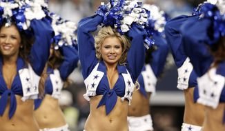 Dallas Cowboys cheerleaders perform before an NFL wildcard playoff football game between the Dallas Cowboys and the Detroit Lions, Sunday, Jan. 4, 2015, in Arlington, Texas. (AP Photo/Brandon Wade) **File**