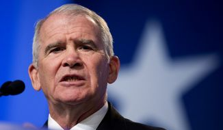 Retired Marine Lt. Col. Oliver North speaks at the 2014 Values Voter Summit in Washington on Sept. 26, 2014.  Prospective Republican presidential candidates are promoting religious liberty at home and abroad at a gathering of evangelical conservatives, rebuking an unpopular President Barack Obama while skirting divisive social issues that have tripped up the GOP. (Associated Press) **FILE**