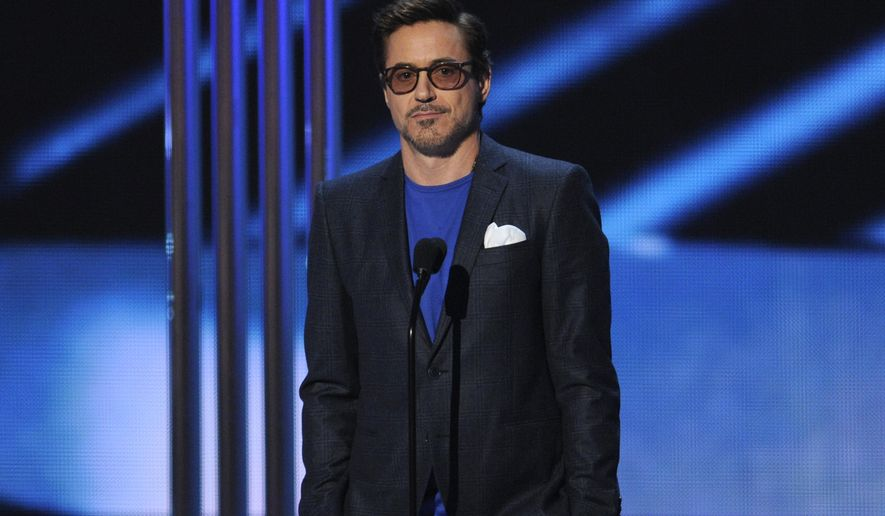 Robert Downey Jr. accepts the award for favorite movie actor at the People's Choice Awards at the Nokia Theatre on Wednesday, Jan. 7, 2015, in Los Angeles. (Photo by Chris Pizzello/Invision/AP)