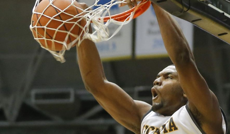 Wichita State forward Shaquille Morris dunks against Bradley during the second half of an NCAA college basketball game, Wednesday, Jan. 7, 2015 in Wichita, Kan. (AP Photo/The Wichita Eagle, Travis Heying) LOCAL TELEVISION OUT; MAGS OUT; LOCAL RADIO OUT; LOCAL INTERNET OUT