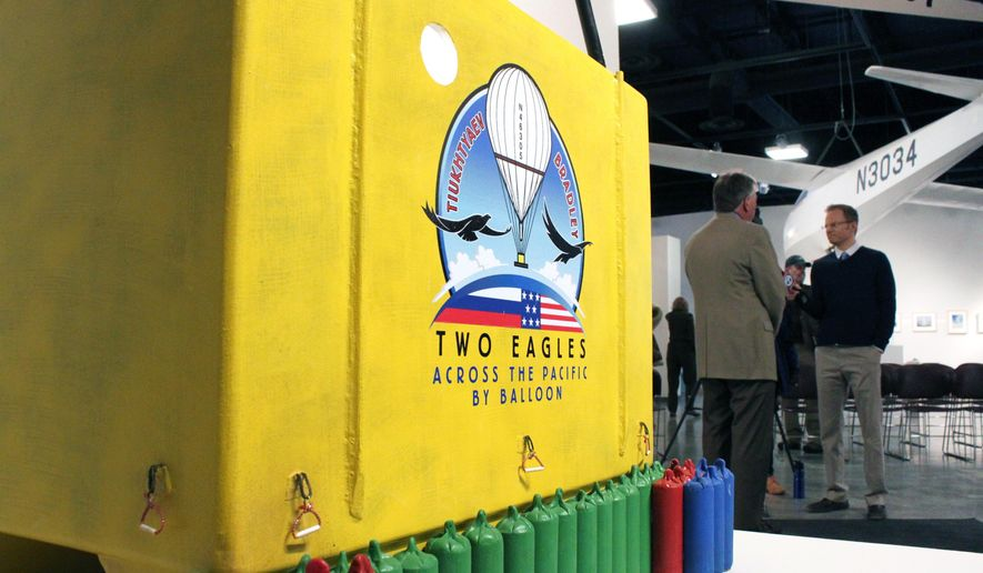 A model of the Two Eagles ballooning capsule is on display at the Anderson Abruzzo International Balloon Museum in Albuquerque, N.M., on Thursday, Jan. 8, 2015. The Two Eagles team has set up a mission control center at the museum and plans to launch its helium-filled balloon from the coast of southern Japan and head toward North America in hopes of breaking a pair of major ballooning records. (AP Photo/Susan Montoya Bryan)