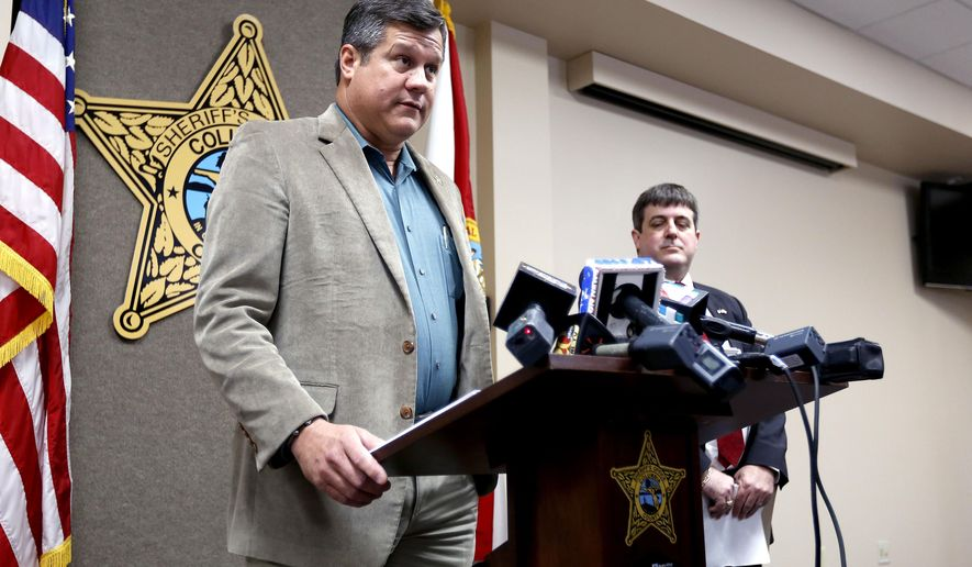 Columbia County Sheriff Mark Hunter speaks during a news conference on Wednesday, Jan. 7, 2015 in Lake City, Fla. about two Columbia County girls accused of killing their brother. Columbia County State Attorney Jeff Seigmeister, right, also spoke. (AP Photo/Matt Stamey, The Gainesville Sun)