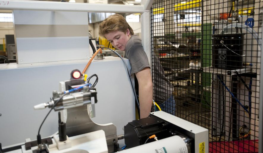 ADVANCE FOR SUNDAY, JAN. 11 - In this photo taken on Dec. 4, 2014, Donavin Anderson, 16, a junior at Springport High School, works at Miller Tool & Die Co. in Jackson, Mich. He takes part in the Jackson Area College and Career Connection Early/Midle College.  (AP Photo/Jackson Citizen Patriot, J. Scott Park)
