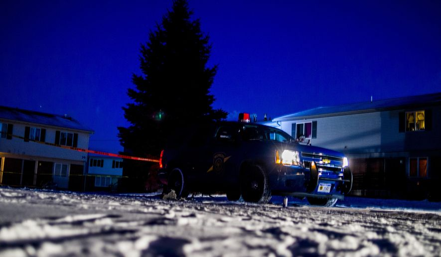 Flint police investigate the scene of a double homicide Wednesday, Jan. 7, 2015 at the Atherton East Apartments in Flint, Mich. Flint Police Chief James Tolbert says two people were fatally shot Wednesday afternoon. Police have yet to release further information, including the names of the victims. The shooting deaths mark the third and fourth homicides in the city within less than a week.  (AP Photo/The Flint Journal, ) LOCAL TELEVISION OUT; LOCAL INTERNET OUT