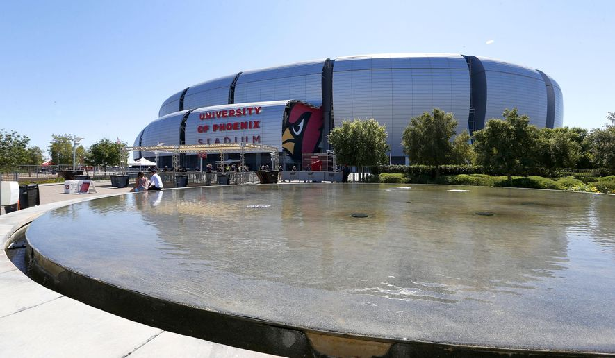 FILE - This Sept. 15, 2013 file photo shows the outside of the University of Phoenix Stadium  in Glendale, Ariz. The Super Bowl will be played here on Feb. 1. A number of special events are taking place in nearby Phoenix for football fans during the days leading up to the big game. (AP Photo/Ross D. Franklin, File)