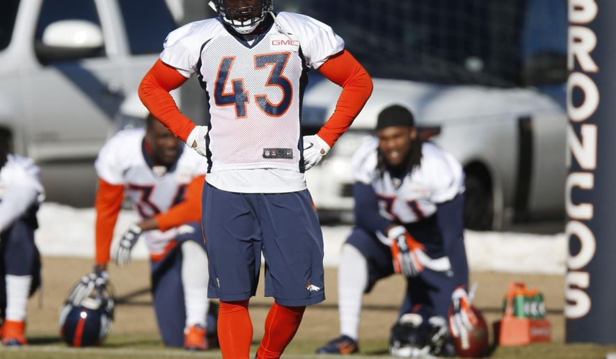 Denver Broncos safety T.J. Ward takes a break during a team practice for an NFL football divisional playoff game against the Indianapolis Colts Thursday, Jan. 8, 2015, in Englewood, Colo. (AP Photo/David Zalubowski)