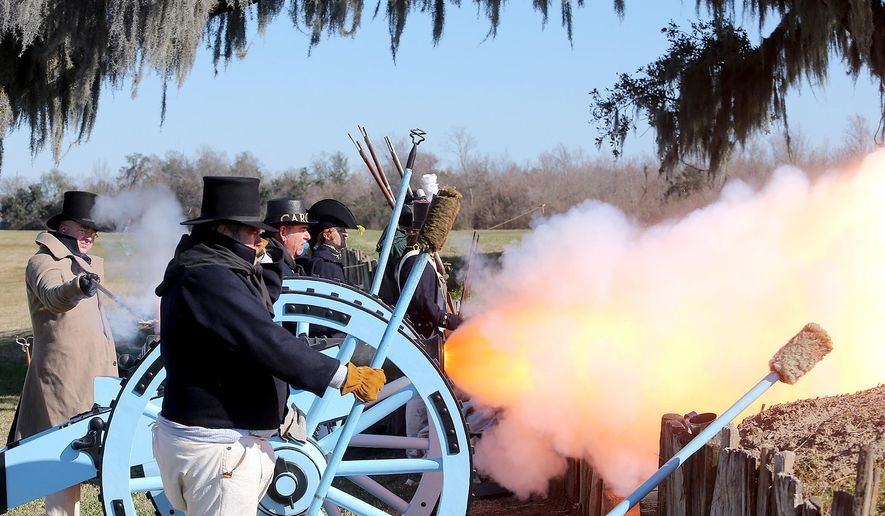Re-enactors fire a cannon as an artillery salute at the closing of the commemoration ceremony for the bicentennial of the Battle of New Orleans held at the Jean Lafitte National Historical Park & Preserve/Chalmette Battlefield on Thursday, Jan. 8, 2015. (AP Photo/NOLA.com/The Times-Picayune, Michael DeMocker)