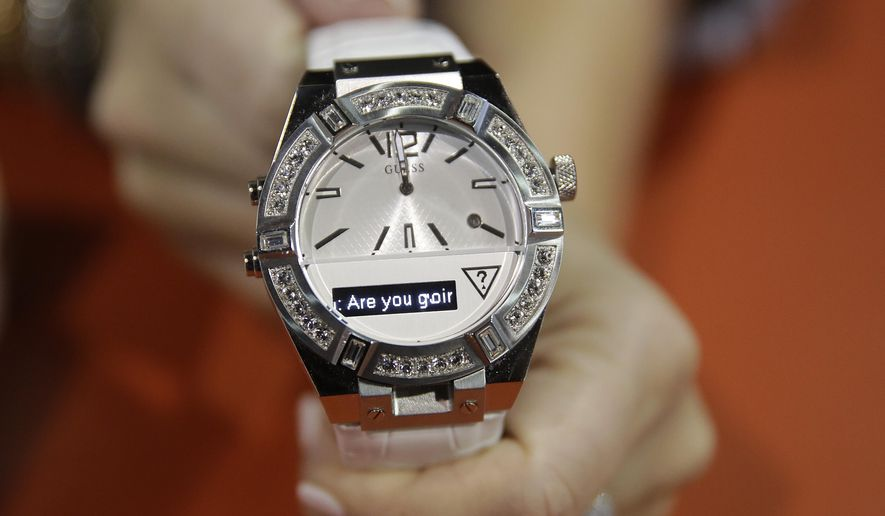 The Guess Connect smartwatch, powered by Martian, is dislpayed at the Martian booth at the International CES Wednesday, Jan. 7, 2015, in Las Vegas. (AP Photo/Jae C. Hong)
