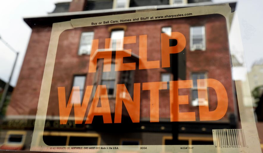 In this Aug. 19, 2013 file photo, a Philadelphia business displays a help wanted sign in its storefront. With the price of oil below $50 a barrel, consumers will have steadily more money to spend, potentially creating job openings at retailers, auto dealers, shipping firms, restaurants and hotels.  (AP Photo/Matt Rourke, File)