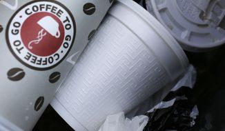 FILE - In this Feb. 14, 2013 file photo, a foam cup, center, is discarded in a trash bin in New York. New York City will move to the forefront of a growing environmental trend by banning food establishments from using plastic foam containers starting this summer, Mayor Bill de Blasio's administration announced Thursday, Jan. 8, 2015.  (AP Photo/Mark Lennihan, File)