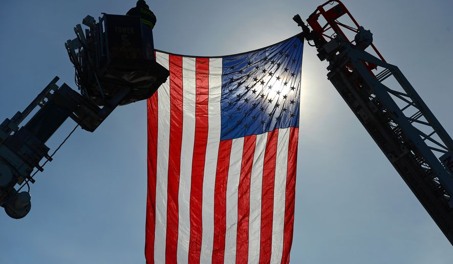 Clayville Fire Department firefighters along with other area fire departments hang American flags over Oriskany Boulevard to pay tribute during the funeral procession for Whitesboro firefighter Jennifer Cortese, Thursday, Jan. 8, 2015. Cortese passed away unexpectedly on Saturday, Jan. 3. She was 43. (AP Photo/Observer-Dispatch, Mark DiOrio)