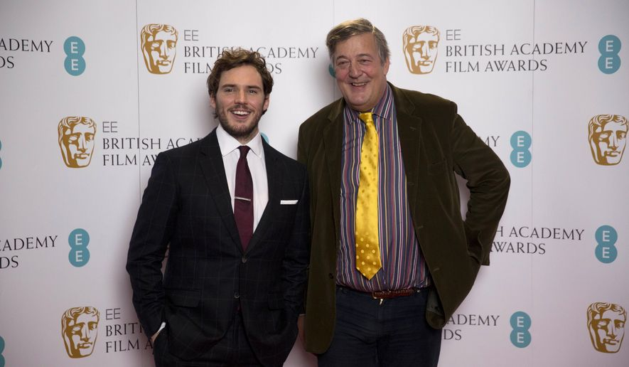 British actors Stephen Fry, right, and Sam Claflin pose for photographers during a photocall to mark the announcement of the BAFTA (British Academy of Film and Television Arts) award nominations in London, Friday, Jan. 9, 2015. Fry will be the host of the ceremony on February 8 at the Royal Opera House in London and announced the nominations Friday with Claflin. (AP Photo/Matt Dunham)