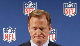 In this Sept. 19, 2014, file photo, NFL Commissioner Roger Goodell pauses as he speaks during a news conference in New York. (AP Photo/Jason DeCrow, File)