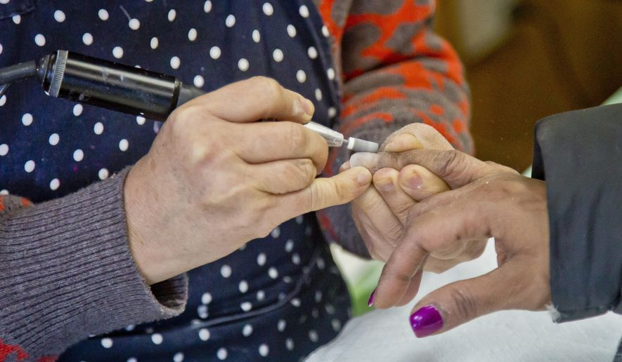 A customer receives a manicure at Castle nail salon, Thursday, Jan. 8, 2015, in New York. (AP Photo/Bebeto Matthews)