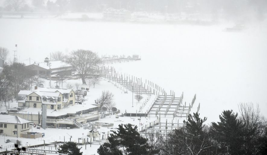 In this Jan. 7, 2015 photo, frozen docks and buildings can be seen from the top of the stairs at Mount Baldhead Park in Saugatuck, Mich. Dangerously cold air has sent temperatures plummeting into the single digits around the U.S., with wind chills driving them even lower. (AP Photo/The Grand Rapids Press, Emily Rose Bennett)