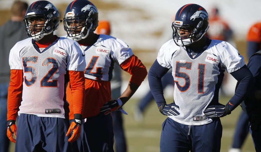 From left, Denver Broncos linebackers Corey Nelson, Brandon Marshall and Todd Davis look on before taking part in a drill during a team practice for an NFL football divisional playoff game against the Indianapolis Colts Thursday, Jan. 8, 2015, in Englewood, Colo. (AP Photo/David Zalubowski)