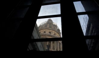 This Dec. 30, 2014 photo shows the capitol dome through a window during restoration work in Havana, Cuba. Fidel Castro's rebels swept into Havana in 1959 and went to work purging the U.S. legacy from a capital that had been a virtual outpost of Washington. The new government moved Cuba's legislature out of this near-perfect replica of the U.S. Capitol building that had loomed over Havana for 30 years, a reminder of Washington's influence. (AP Photo/Ramon Espinosa)