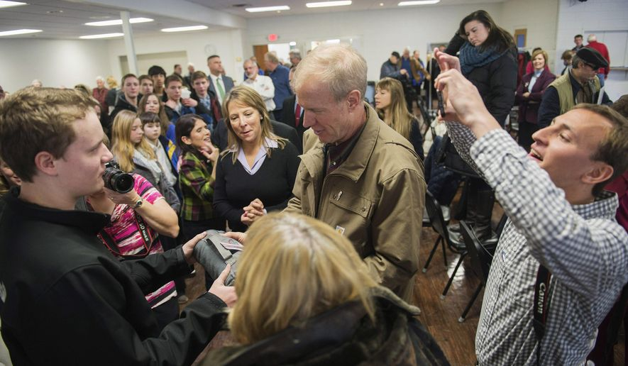 Illinois Republican Gov.-elect Bruce Rauner visits with people Friday Jan. 9, 2015, at the Pearce Community Center in Chillicothe, Ill., on the first of a two-day tour of smaller and midsized communities ahead of his inauguration Monday in Springfield. (AP Photo/Journal Star, David Zalaznik)