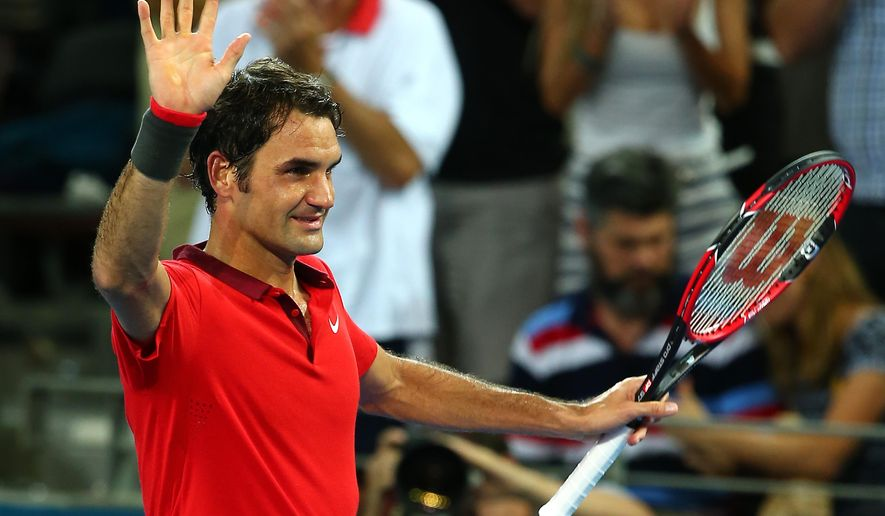 Roger Federer of Switzerland waves at the crowd after he won his match against John Millman of Australia 4-6, 6-4, 6-3 during the Brisbane International tennis tournament held in Brisbane, Australia, Thursday, Jan. 8, 2015. (AP Photo/Tertius Pickard)