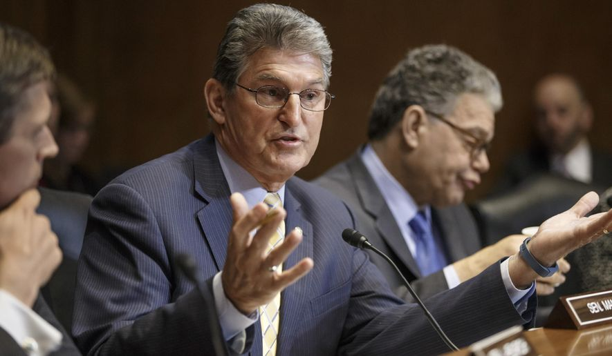 Sen. Joe Manchin, D-W.V., a Democratic sponsor of the long-stalled Keystone XL pipeline bill, flanked by Sen. Al Franken, D-Minn., right, and Sen. Martin Heinrich, D-N.M., left, makes his plea at the Senate Energy and Natural Resources Committee markup on the controversial project, Thursday, Jan. 8, 2015, on Capitol Hill in Washington. As promised by Republican leaders who now hold the majority in Congress, the Keystone bill is at the top of their agenda after it fell short of passage in December when Democrats ruled the Senate. (AP Photo/J. Scott Applewhite)