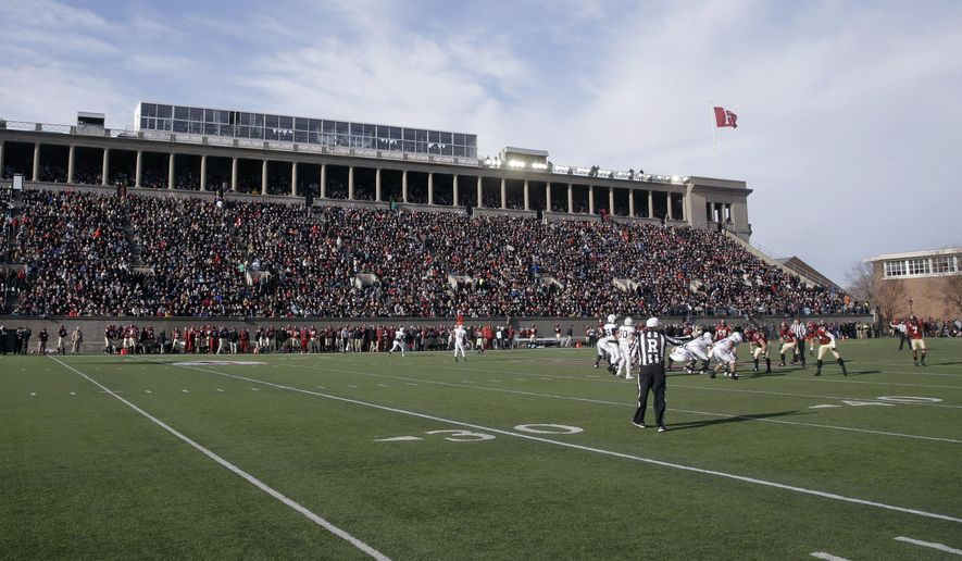 FILE - In this Nov. 22, 2014 photo, Harvard and Yale football teams compete in Harvard Stadium in Cambridge, Mass. The U.S. Olympic Committee picked Boston on Thursday, Jan. 8, 2015, as its bid city for the 2024 Summer Games. The city will be presented to the International Olympic Committee for a vote in 2017. Rome also is in the bidding, along with Hamburg or Berlin, Germany. France and Hungary also are considering bids. Boston's bid enlists the area's 100 colleges and universities--and their existing and envisioned athletic facilities--as potential hosts for Olympic venues. (AP Photo/Stephan Savoia, File)