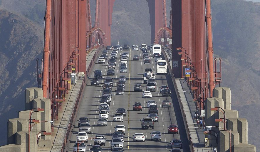 FILE - This Sept. 19, 2013 file photo shows cars on the Golden Gate Bridge during the end of the morning commute in San Francisco. The Golden Gate Bridge will shut down to private vehicles for 52 hours starting at midnight Friday Jan. 9, 2015 so workers can install a moveable median barrier designed to prevent head-on collisions, part of an effort to increase safety along the iconic structure. (AP Photo/Eric Risberg, file)