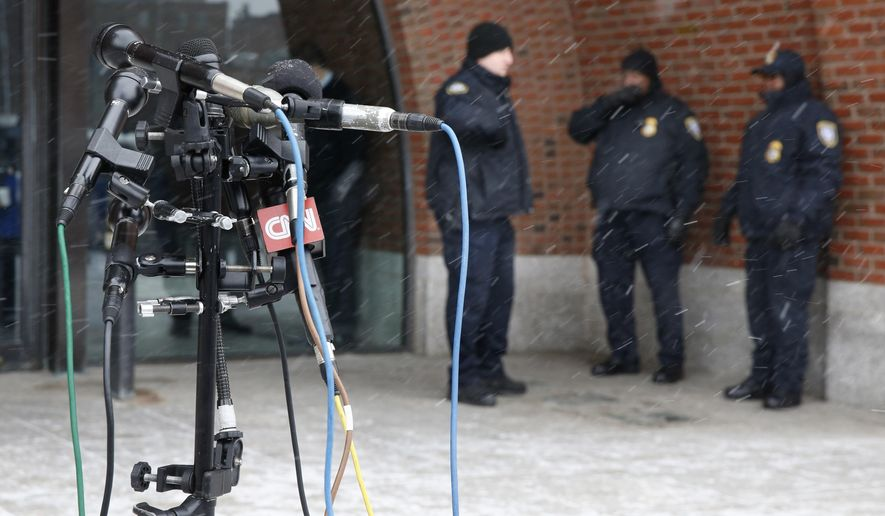 Police stand guard behind television microphones set up outside the federal courthouse in Boston,Tuesday, Jan. 6, 2015, on the second day of jury selection in the trial of Boston Marathon bombing suspect Dzhokhar Tsarnaev. Tsarnaev is charged with the April 2013 attack that killed three people and injured more than 260. His trial is scheduled to begin on Jan. 26. He could face the death penalty if convicted. (AP Photo/Michael Dwyer)