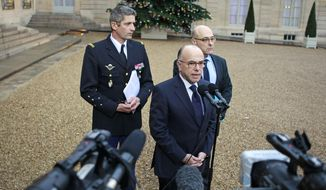 French interior minister Bernard Cazeneuve addresses reporters at the end of a crisis meeting with French President Francois Hollande, at the Elysee Palace in Paris, Friday Jan. 9, 2015. Investigators are scrutinizing the recent past of two brothers with al-Qaida sympathies, as a manhunt for the suspects in the newsroom massacre at a satirical French weekly enters its third day. (AP Photo/Remy de la Mauviniere)