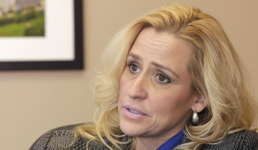 """Arkansas Attorney General-elect Leslie Rutledge is interviewed in Little Rock, Ark., Friday, Jan. 9, 2015. While most of her recent predecessors have aspired to higher office, Rutledge said Friday she doesn't plan to spend time on """"political calculations."""" (AP Photo/Danny Johnston)"""