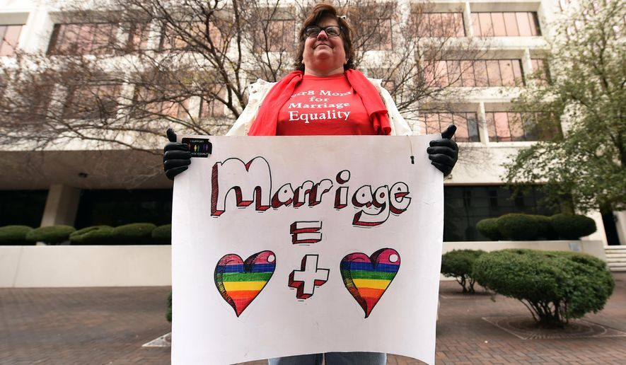 Helen Barnes holds a sign of support for gay marriage outside of the 5th U.S. Circuit Court of Appeals, Friday, Jan. 9, 2015, in New Orleans. Opponents and supporters of gay marriage argued their sides before the 5th U.S. Circuit Court of Appeals, on gay marriage bans in Texas, Louisiana and Mississippi . (AP Photo/Stacy Revere)