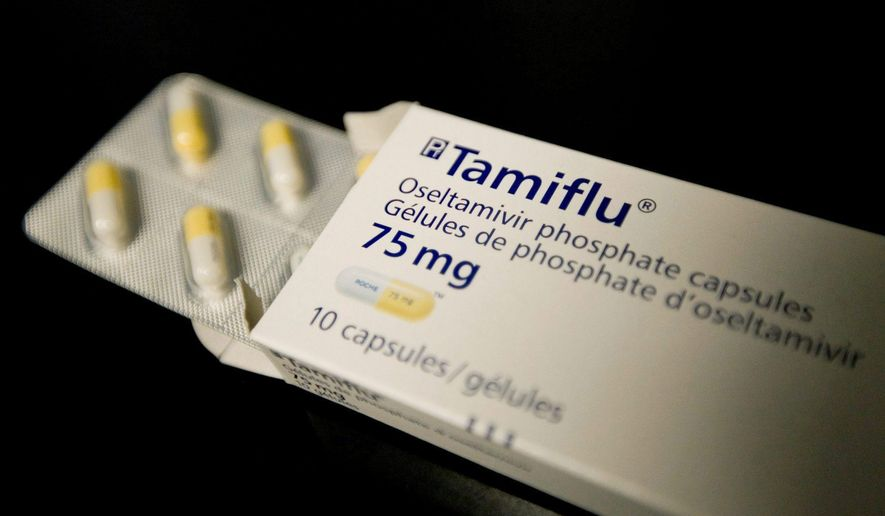 FILE- This April 30, 2009, file photo shows a box of Tamiflu in a Toronto health clinic. The Centers for Disease Control and Prevention on Friday, Jan. 9. 2015, sent a new alert to doctors, advising prompt use of Tamiflu and other antivirals for hospitalized flu patients and those at higher risk for complications like pneumonia. (AP Photo/The Canadian Press, Darren Calabrese, File)