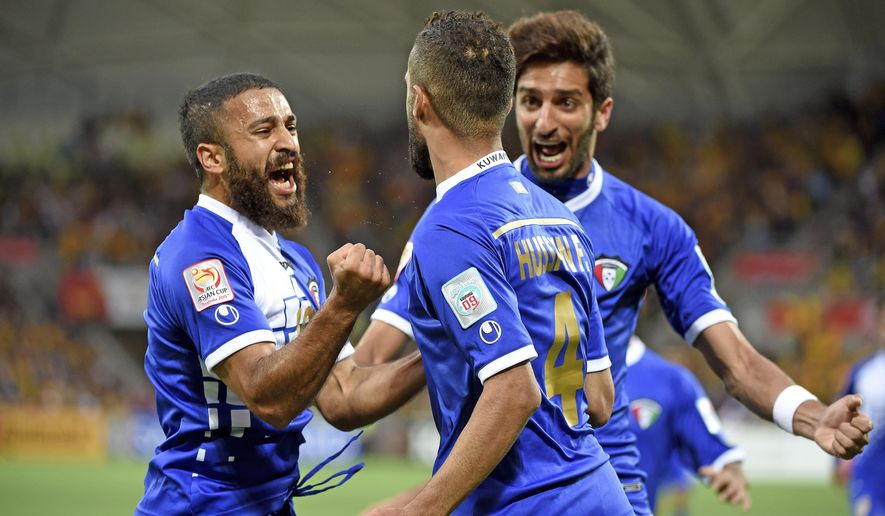 Ali Hussain Fadhel of Kuwait, left, celebrates with teammates after scoring the first goal of the match during their first round soccer match of the AFC Asia Cup at the Melbourne Rectangular Stadium in Melbourne, Australia, Friday, Jan. 9, 2015. (AP Photo/AAP, Joe Castro)  AUSTRALIA OUT, NEW ZEALAND OUT, PAPUA NEW GUINEA OUT, SOUTH PACIFIC OUT, NO SALES, NO ARCHIVES