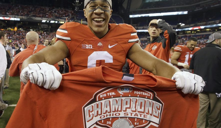 FILE - In this Dec. 6, 2014 file photo, Ohio State wide receiver Evan Spencer celebrates following the Big Ten Conference championship NCAA college football game against Wisconsin in Indianapolis. While many might pick sackmaster Joey Bosa, 1,600-yard rusher Ezekiel Elliott or one of a dozen others, head coach Urban Meyer says the team MVP is Spencer. (AP Photo/Darron Cummings, File)
