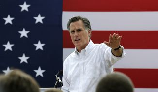 Mitt Romney, the former Republican presidential nominee, addresses a crowd of supporters while introducing New Hampshire Senate candidate Scott Brown at a farm in Stratham, N.H., in this July 2, 2014, file photo. Romney told a small group of Republican donors that he's eying a third run at the White House. (AP Photo/Charles Krupa, File)