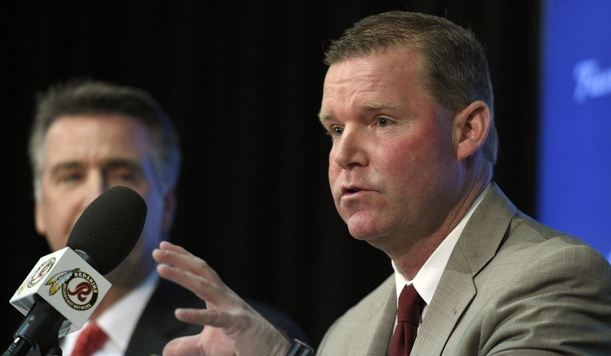 Scot McCloughan, right, speaks during an NFL football press conference where he was introduced as the Washington Redskins new general manager, Friday, Jan. 9, 2015, in Ashburn, Va. (AP Photo/Nick Wass)