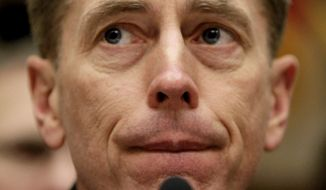 File-This April 9, 2008, file photo shows Gen. David Petraeus testifies on Capitol Hill in Washington. A U.S. official says the Justice Department is weighing bringing criminal charges against the former CIA Director over the handling of classified information. The official says investigators have presented senior-level Justice Department officials such as Attorney General Eric Holder with information on the case to make a decision. (AP Photo/Pablo Martinez Monsivais, File)