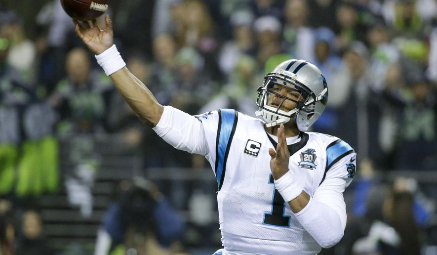 Carolina Panthers quarterback Cam Newton passes against the Seattle Seahawks during the first half of an NFL divisional playoff football game in Seattle, Saturday, Jan. 10, 2015. (AP Photo/Elaine Thompson)