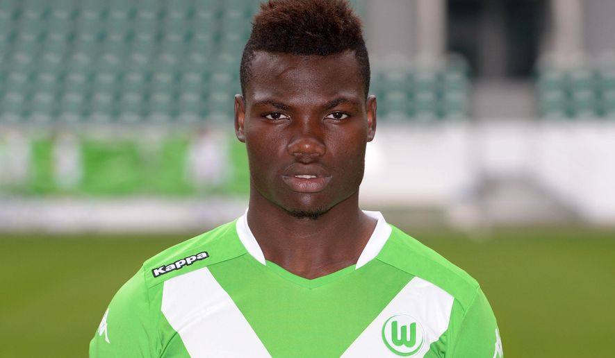 FILE - The July 30, 2014 file photo shows Junior Malanda of German soccer Bundesliga club VfL Wolfsburg posing during the official photo opp of the club in Wolfsburg, northern Germany. Wolfsburg midfielder and Belgium youth international Junior Malanda was killed in a car crash on Saturday, Jan 10, 2015 Wolfsburg police said. (AP Photo/dpa, Peter Steffen)