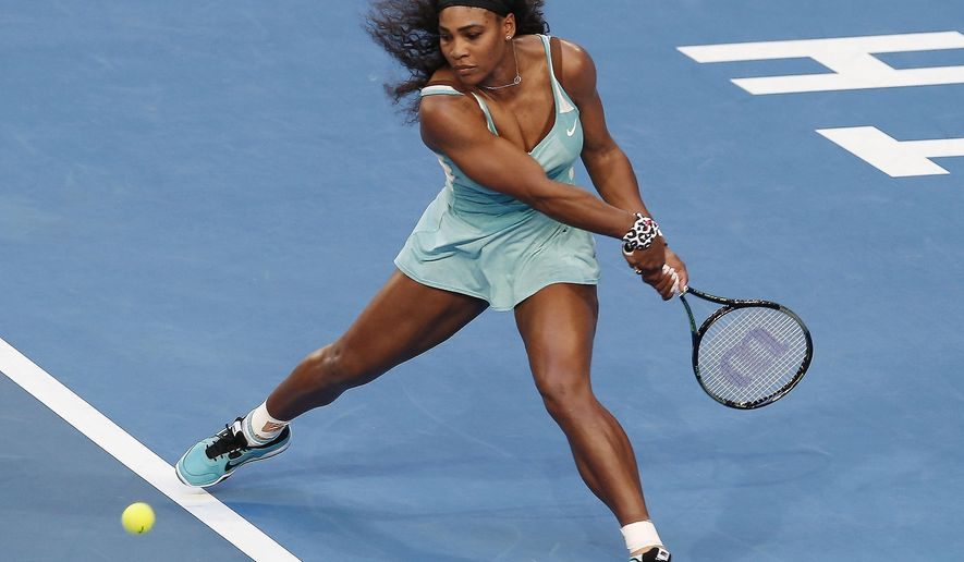 Serena Williams of the U.S. plays a backhand shot against Agnieszka Radwanska of Poland during the women's singles final at the Hopman Cup tennis tournament in Perth, Australia, Saturday, Jan. 10, 2015. (AP Photo/Theron Kirkman)