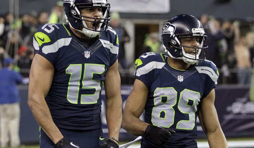 Seattle Seahawks wide receiver Jermaine Kearse (15) celebrates after scoring on a 63-yard touchdown reception next to wide receiver Doug Baldwin (89) during the first half of an NFL divisional playoff football game against the Carolina Panthers in Seattle, Saturday, Jan. 10, 2015. (AP Photo/John Froschauer)